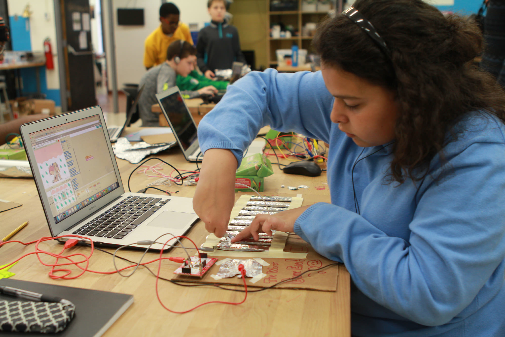youth working with a makey makey