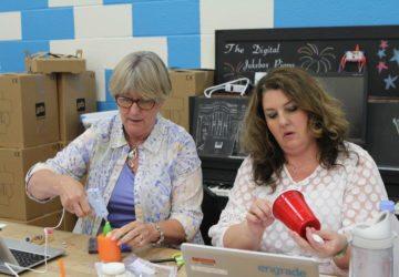 educators making artbots at a table