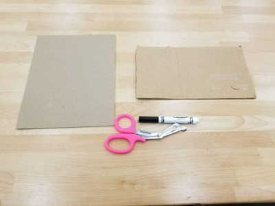 laying out the chipboard scissors and marker