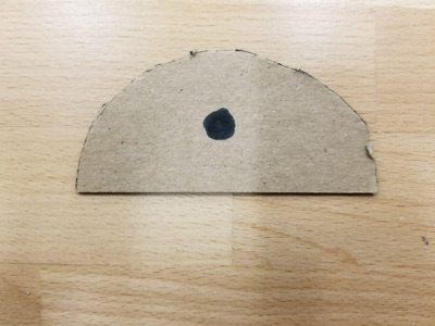 marking half-circle cardboard with a dot to mark where the screw will go